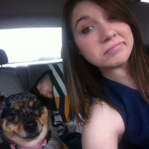 PetFirst Pet Insurance Customer Service Representative Tamzin Bennett posing with her dog, Gizmo, on the car ride to work.